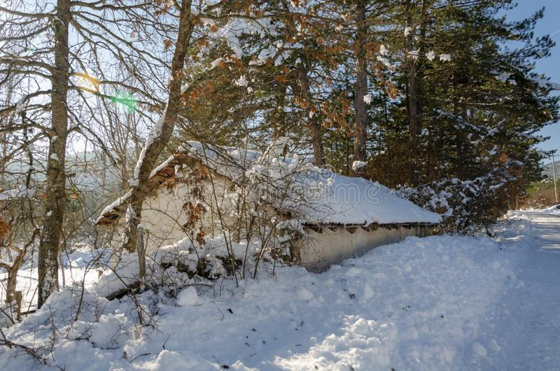 Winter landscape with a wooden hut royalty free stock photos