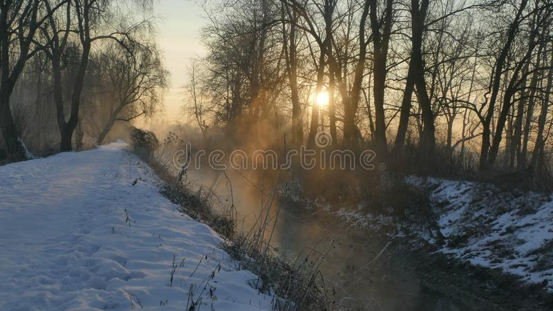 Winter light of the rising sun. A warm stream heated by rays evaporates on a cold day. A game of shadows with light is created. January, morning in Silesia stock photos