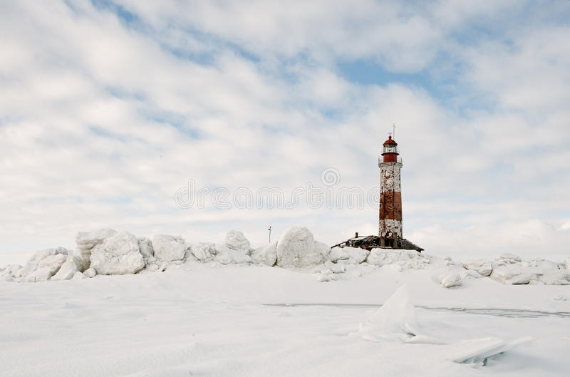 Winter Lighthouse. The Lighthouse island in the winter on the Ladoga Lake. Russia royalty free stock photography