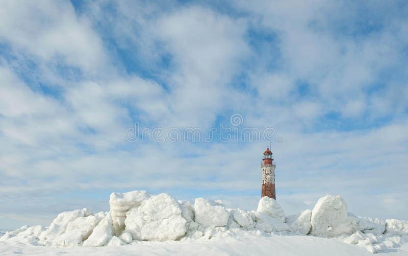 Winter Lighthouse. The Lighthouse island in the winter on the Ladoga Lake. Suho Island. Russia stock photography