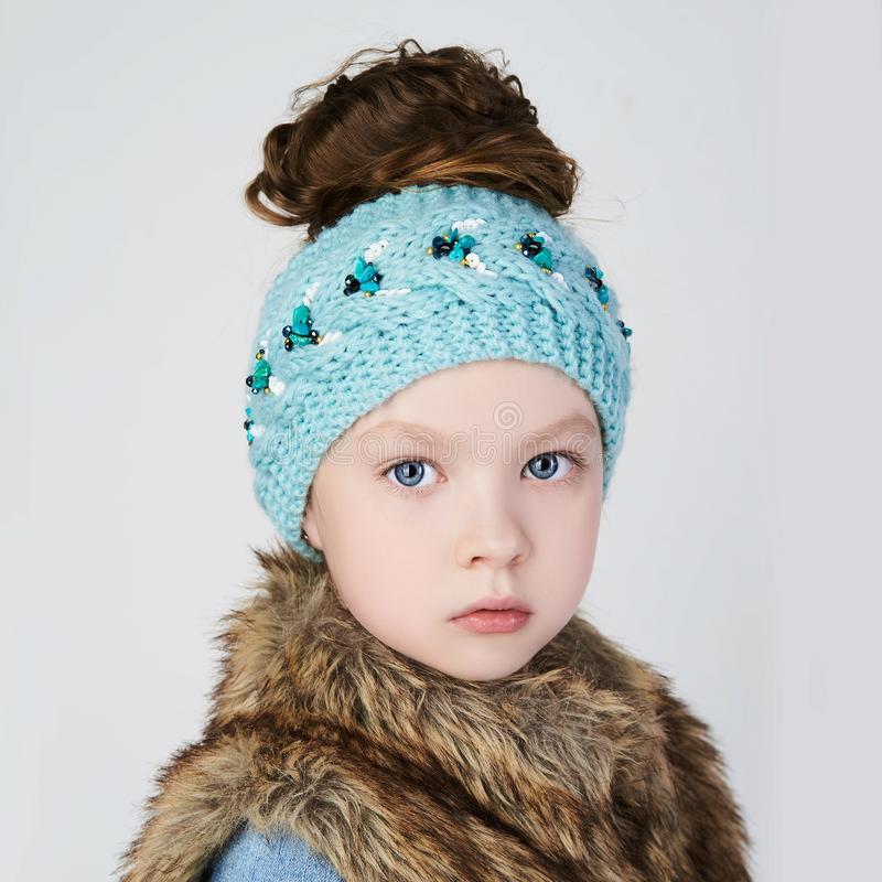 Winter little girl in fur and hat stock photos