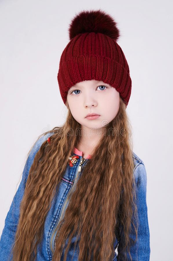 Winter little girl hat. Beautiful child model stock images