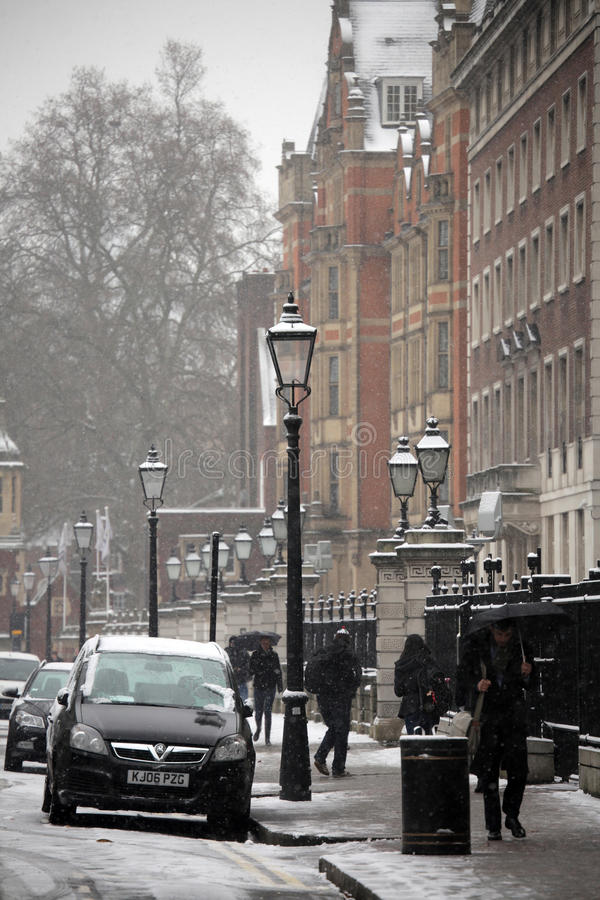 Winter in London. Unusual severe snowy weather conditions in winter in London stock image