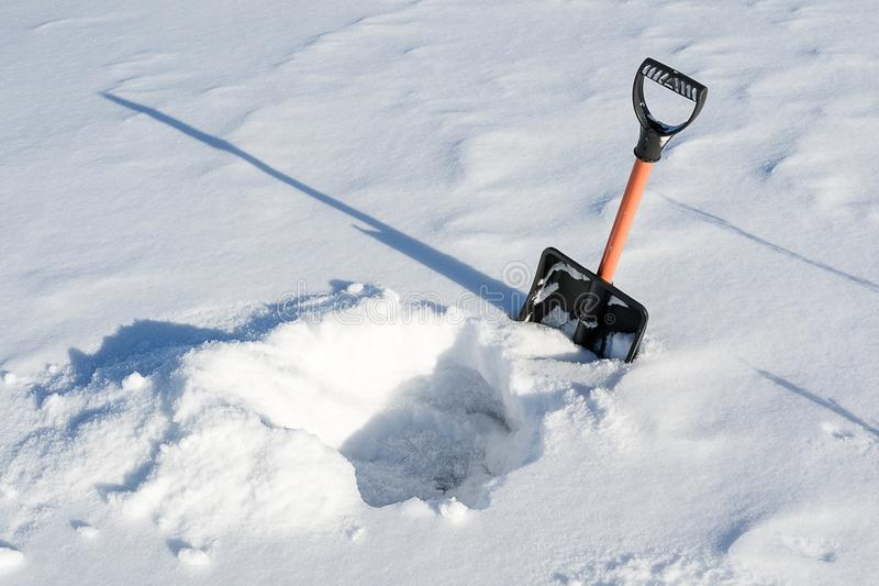In winter, a lot of snow and shovel, dug a snow pit shovel. In winter, a lot of snow and shovel, dug a snow stock photo
