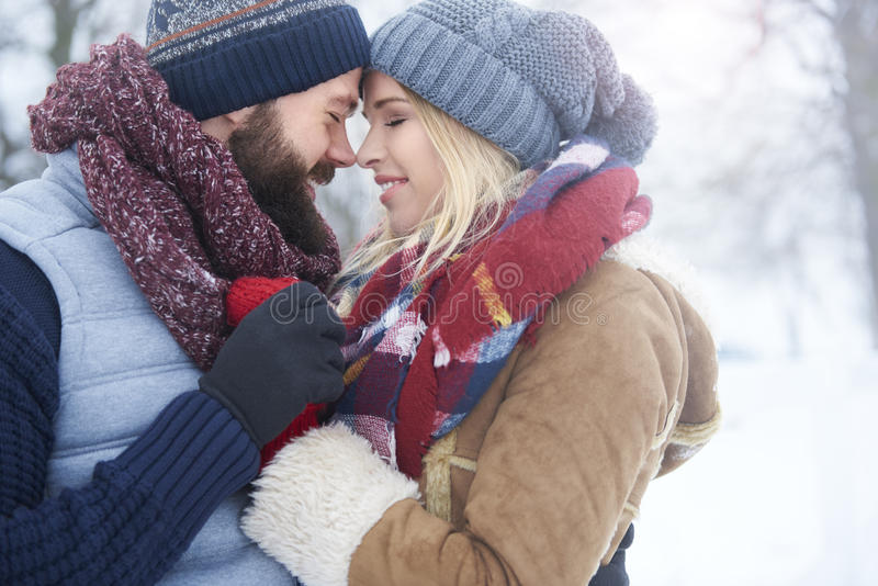 Winter love. Of two young people stock images