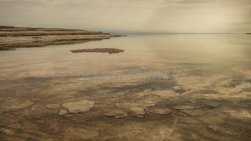 Winter at the lowest place in the world. The Dead sea, the lowest place in the world, -424m below se level , Ein Gedi, the border between israel and the Kingdom stock image