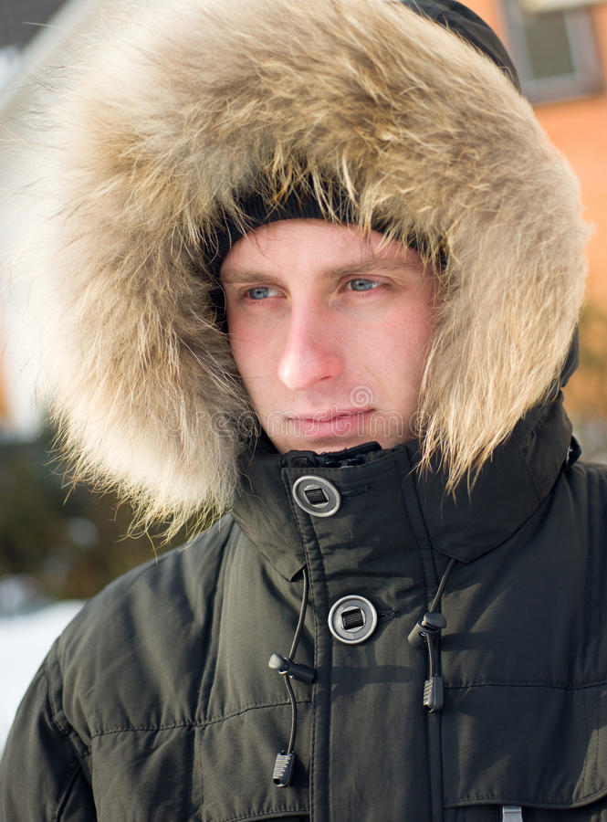 Download Winter - Man In Warm Jacket With Furry Hood Stock Photo - Image: 12950460