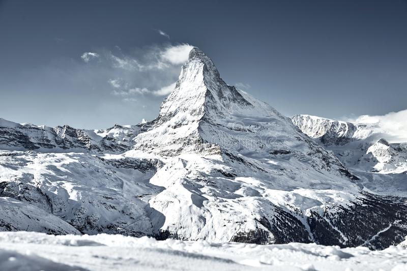 Matterhorn mountain covered by cloud like a flag royalty free stock photo