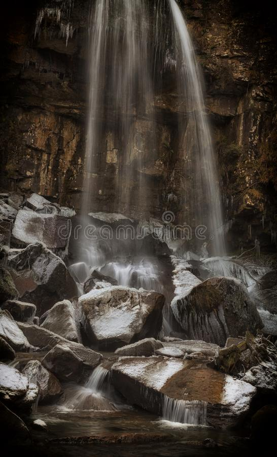 Winter at Melincourt waterfall. Dramatic Melincourt waterfalls in the grip of Winter in the village of Resolven, South Wales, UK stock photo