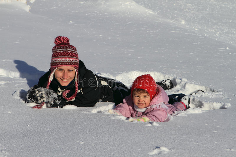 Winter : mom with baby in snow stock photos