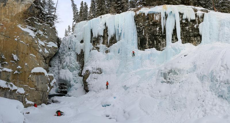 Panorama on Johnston Canyon`s Upper falls with ice climbers , bow river, alberta Canada royalty free stock photo