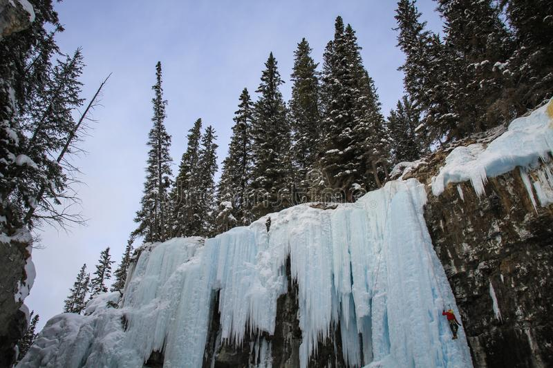 Johnston Canyon`s Upper falls with ice climbers , bow river, alberta Canada. During the winter months December to April, Johnston Canyon is a favourite place to royalty free stock image
