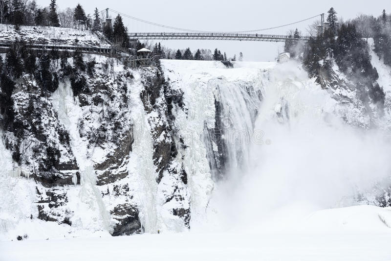 Winter at Montmorency Falls. Frozen waterfall and extreme cold weather conditions make this area popular with climbers, hikers and extreme sport lovers in winter stock image