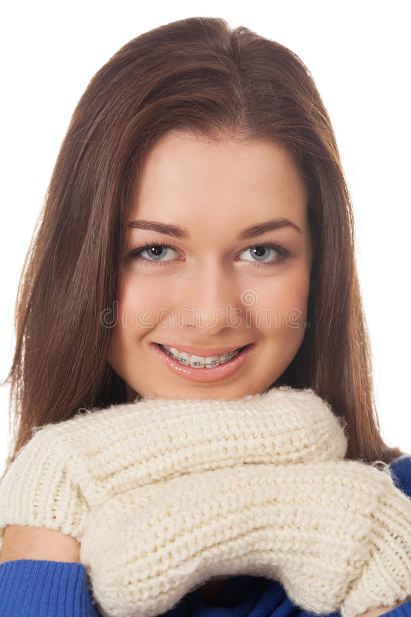 Winter mood. Smiling girl with braces in winter mood stock photography