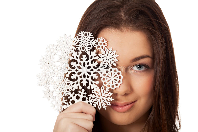 Winter mood. Girl with snowflake on isolated white stock photos