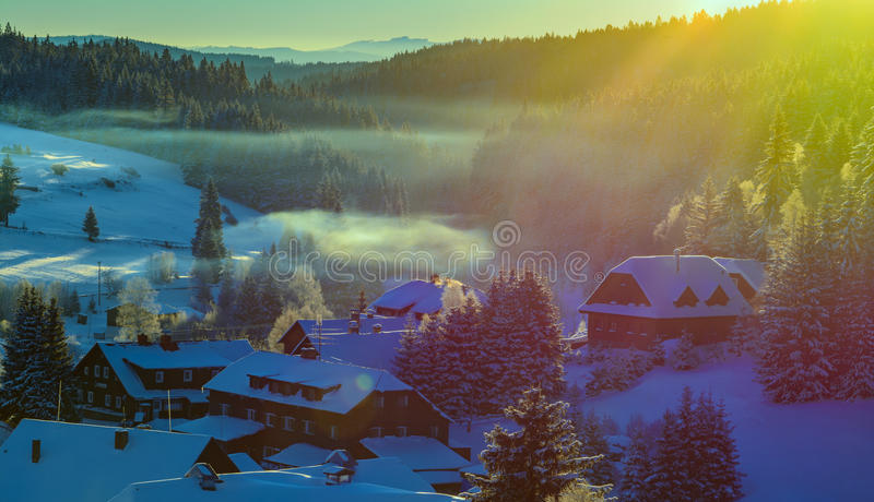 Winter morning landscape. Small village Kvilda in National Park Sumava before day. Czech Republic stock image
