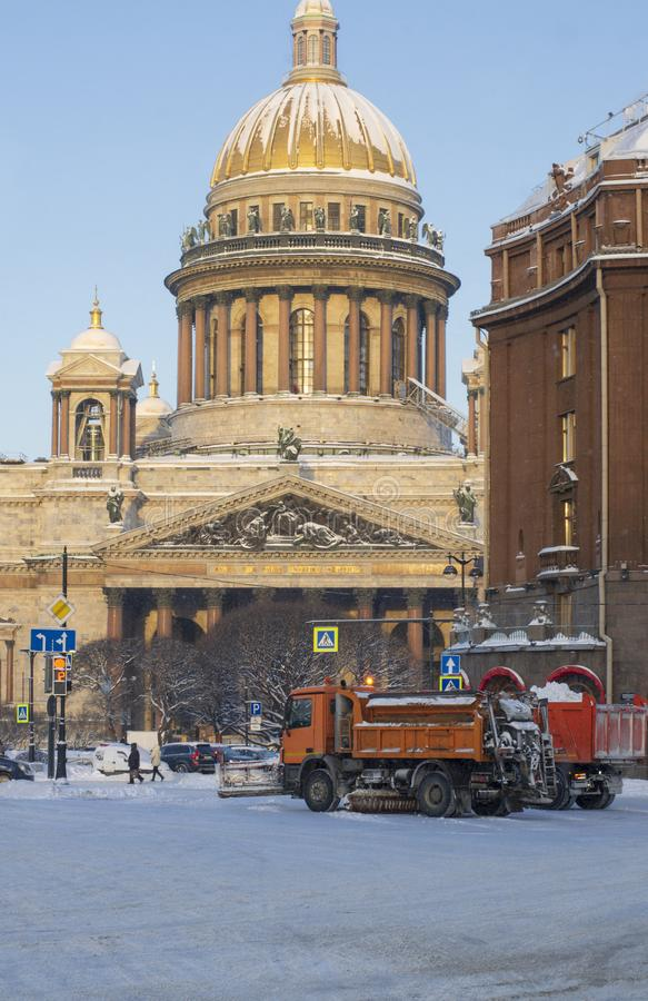 Winter morning near St. Isaac`s Cathedral snow removal equipment clears the city royalty free stock images