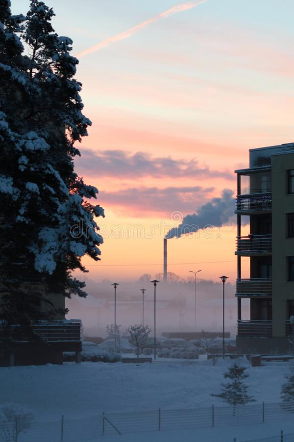 Winter morning sunrise with chimney royalty free stock photo