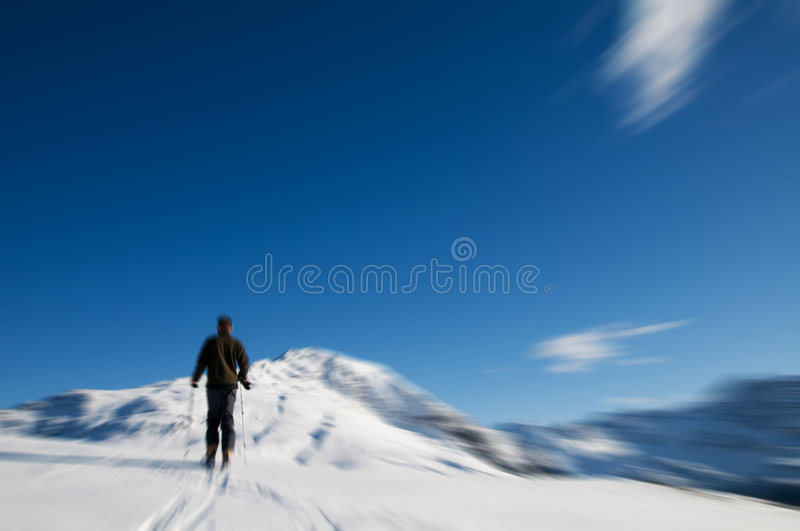 Winter mountain climbing. Winter sports - mountain climbing. Motion blurred royalty free stock images