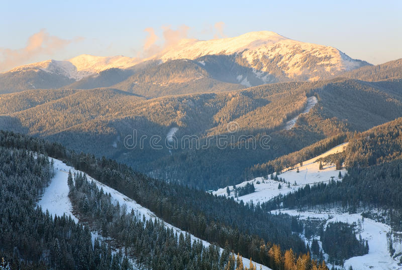 Winter mountain landscape. Winter calm mountain landscape (view from Bukovel ski resort (Ukraine) to Svydovets ridge stock photo