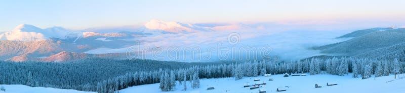 Winter mountain landscape. Morning winter calm mountain panorama with sheds group and mount ridge behind (Carpathian Mountains, Ukraine). Nine shots stitch image stock images