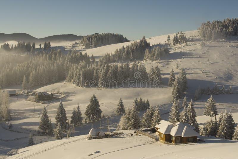 Winter mountain Landscape. On a romanian village royalty free stock photo