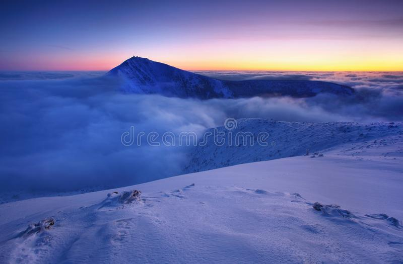 Winter mountain landscape with fog in the Giant Mountains on the Polish and Czech border - Karkonosze National Park. stock photo