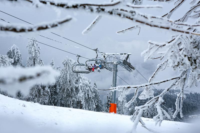 Winter mountain landscape with modern ski lift. Extreme sports royalty free stock photography