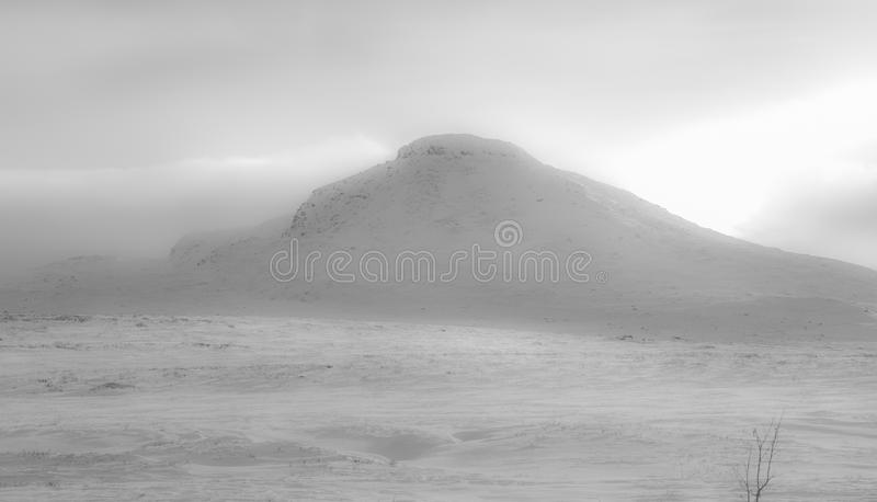 Winter mountain landscape. Norwegian winter mountain landscape with distant peak stock image