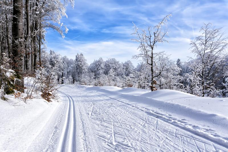 Winter mountain landscape. Mountain road with trail to cross-country skiing stock image