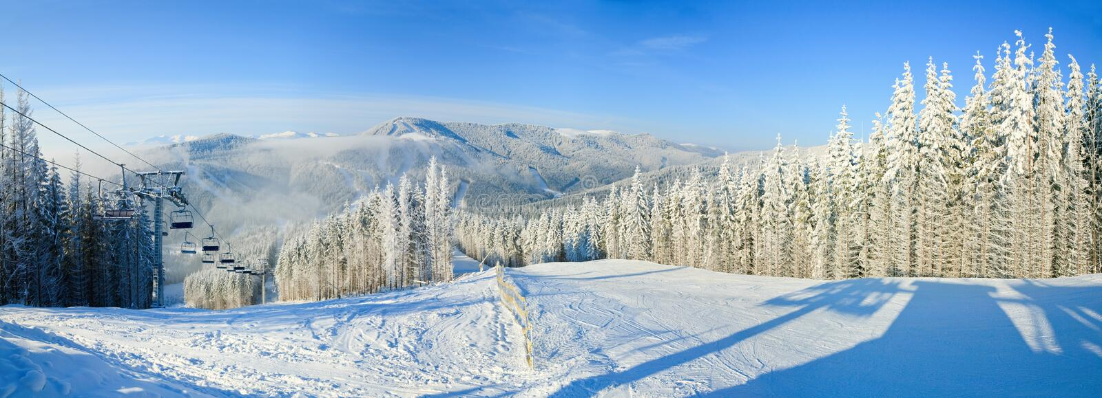 Winter mountain landscape with ski lift. And skiing slope. Bukovel ski resort, Ukraine. Three shots stitch image royalty free stock image