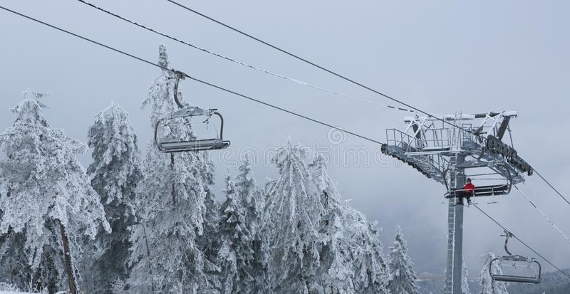 Winter mountain landscape with with modern ski lift chair. Winter mountain landscape with skiing slope-extreme sports stock photos