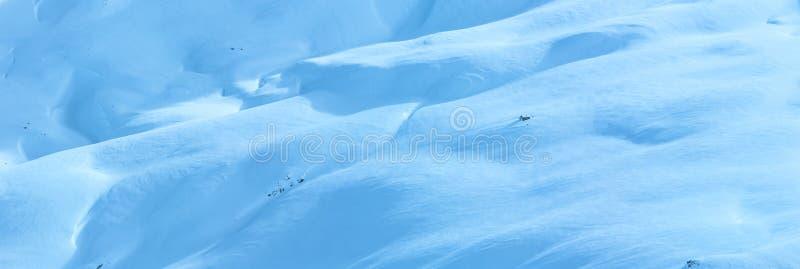 Winter mountain panorama (Austria). Small wooden house on winter mountain slope. Panorama royalty free stock photos
