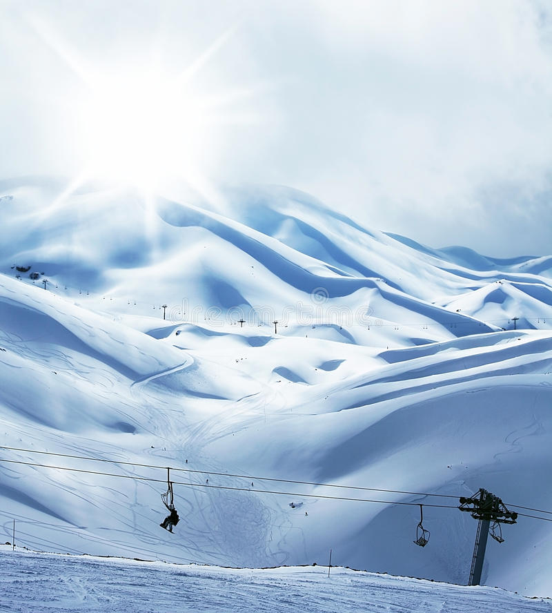 Winter mountain ski resort. Landscape with snow, sunny sky and chairlift stock images