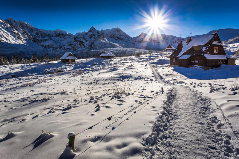 Winter mountain trail to a warm shelter. Europe royalty free stock photo