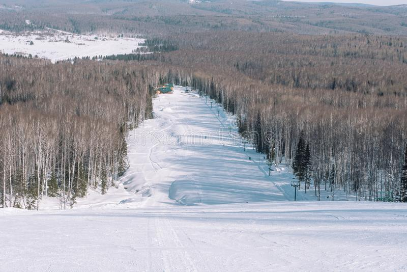 Winter mountain view from above. View down from the mountain in winter. Winter landscape. Winter in Siberia stock photos