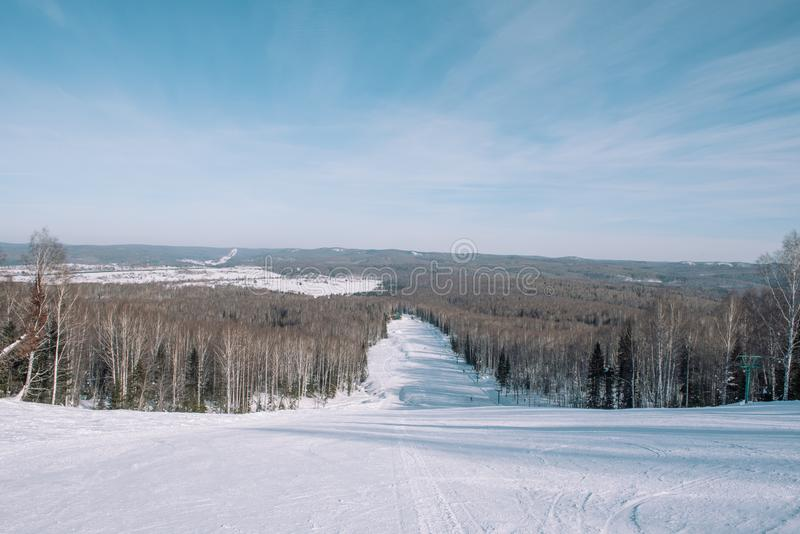 Winter mountain view from above. View down from the mountain in winter. Winter landscape. Winter in Siberia royalty free stock images