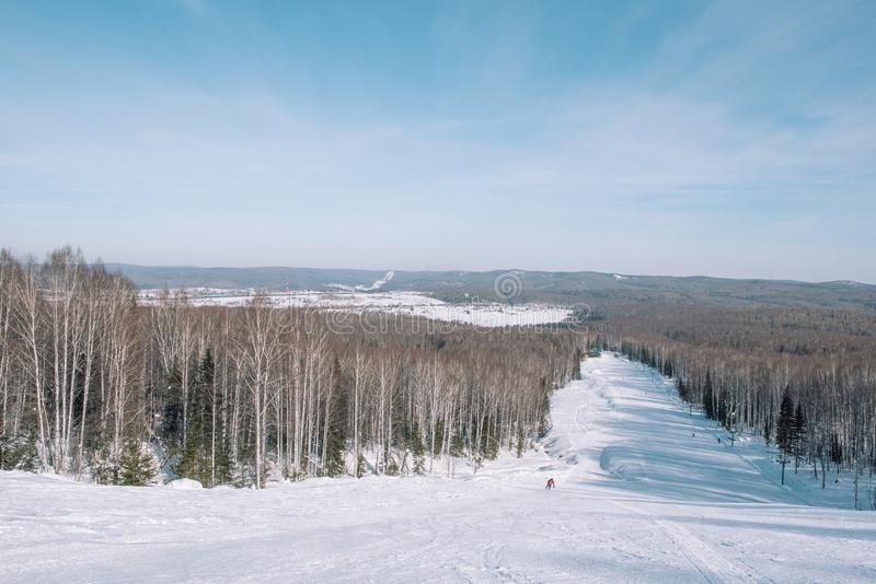 Winter mountain view from above. View down from the mountain in winter. Winter landscape. Winter in Siberia stock image
