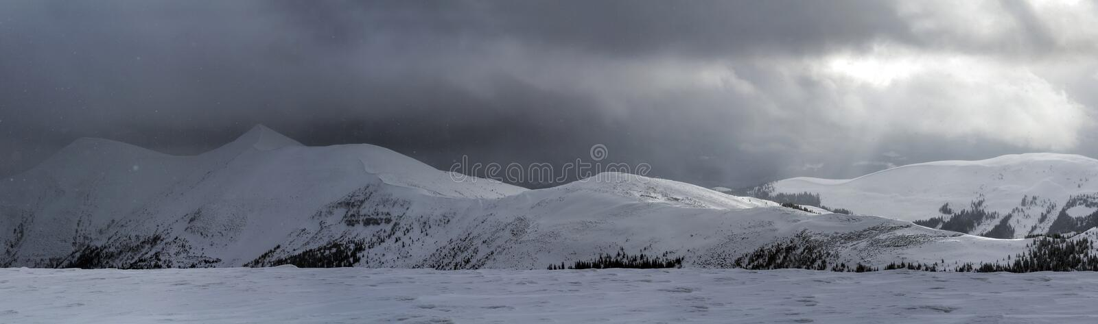 Winter mountain view in Carpathian mountains with dramatic clouds royalty free stock photos