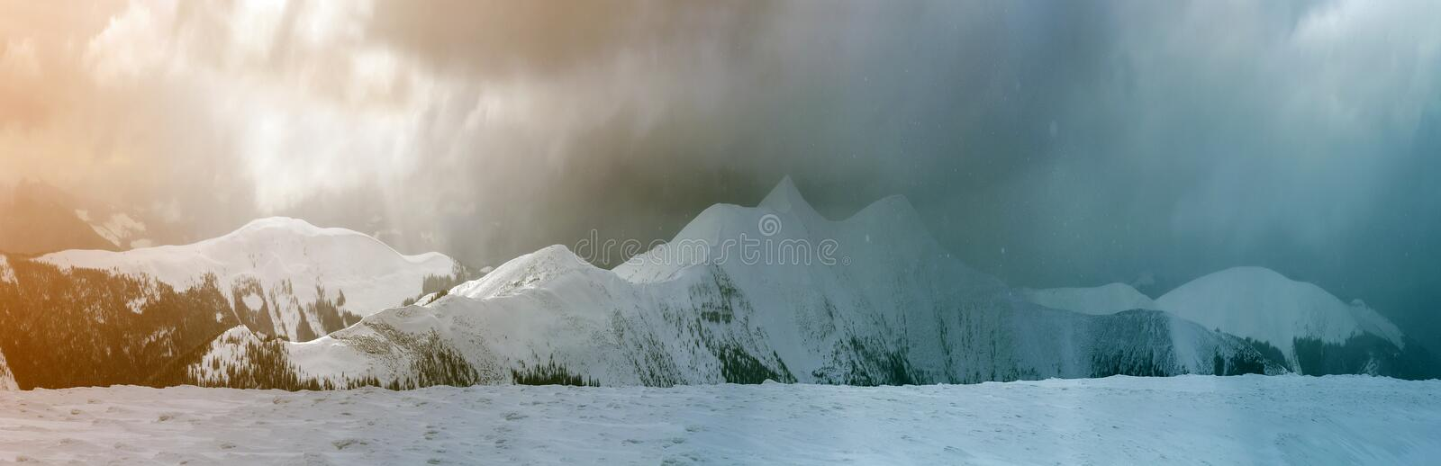 Winter mountain view in Carpathian mountains with dramatic clouds.  royalty free stock photo
