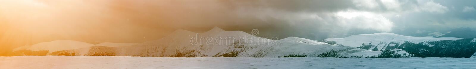 Winter mountain view in Carpathian mountains with dramatic clouds.  royalty free stock photography