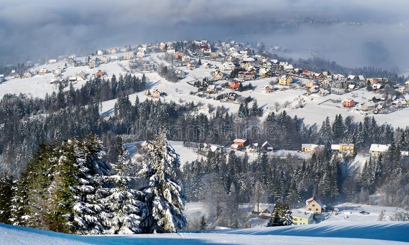 Winter in a mountain village. Fairytale world only outside. life here is full of hardships stock image