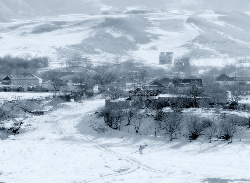 Winter mountain village. Winter mountain white landscape: russian village in the mountain area covered by snow with trees, roads and houses. Can be used as a stock photography