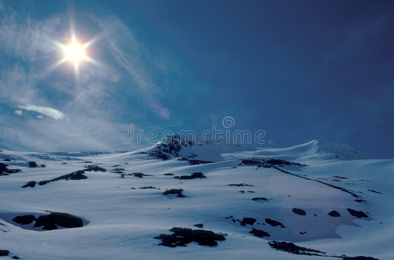 Winter mountains. Sun over Coast Mountains, B.C., Canada royalty free stock images