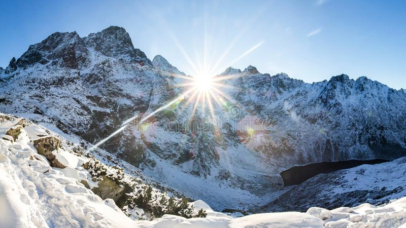 Winter mountains. Alpine winter nature landscape. Snowy mountain with bright sun. Sunny morning in Austrian Alps stock photos