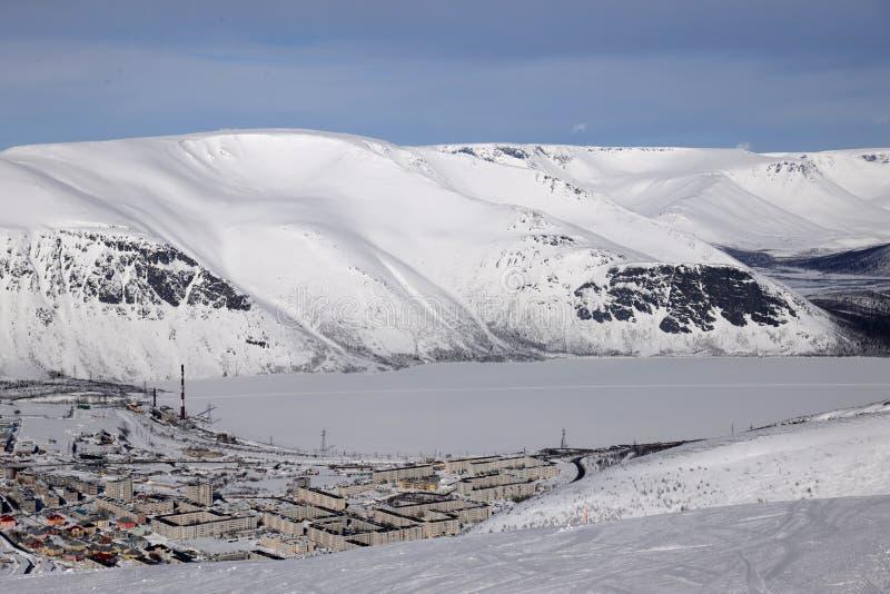 Winter mountains with frozen lake in Russia , Khibiny (Hibiny), Kola Peninsula. There are winter mountains and downhill skiing in Khibiny (Hibiny), Russia, Kola stock photography