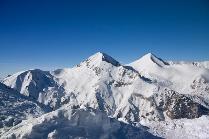 Winter mountains landscape in sunny day royalty free stock photography