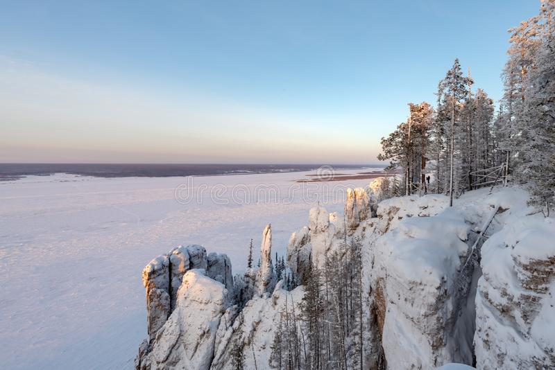Winter mountains landscape with trees and blue sky. Stone Pillars in the Natural Park Lenskie Stolby Lena Pillars, Yakutia, Russia. Top view. Panorama stock photo