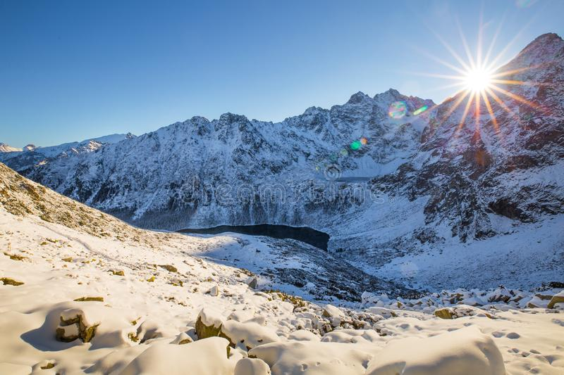 Winter mountains. Morning landscape of Tatra mountains with bright sun with sunbeams. Mountains hills covered with snow illuminate stock image