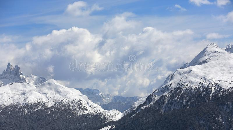 Winter mountains, panorama - snow-capped peaks of the Italian Alps. Dolomites, Alps, Italy, Trentino Alto Adige. Snow-capped mount royalty free stock images